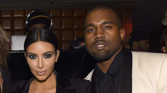 Kim Kardashian and Kanye West attend John Legend