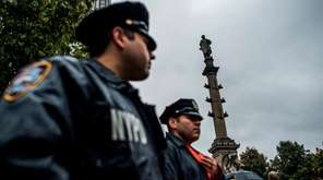 NYPD officers patrol Manhattan's Columbus Circle and the