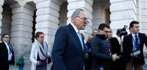 Senate Minority Leader Chuck Schumer (D-N.Y.), center, walks