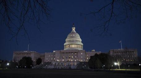 The Capitol is seen illuminated in Washington on