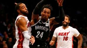 Rondae Hollis-Jefferson #24 of the Brooklyn Nets tries