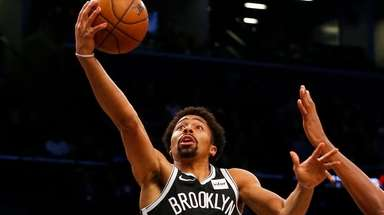 Spencer Dinwiddie of the Nets goes to the