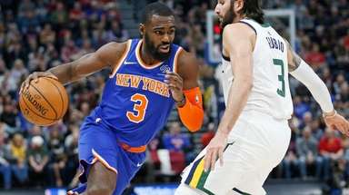 Knicks guard Tim Hardaway Jr. drives around Jazz