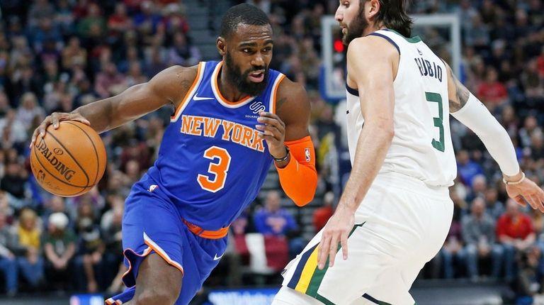 Knicks guard Tim Hardaway Jr. drives around Jazz