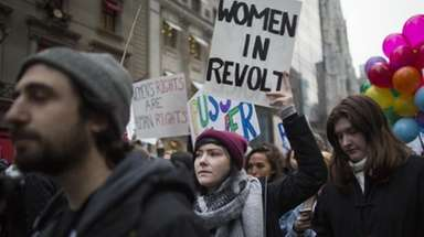 Demonstrators march along Fifth Avenue in New York