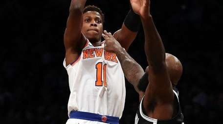 Frank Ntilikina of the Knicks shoots against Quincy