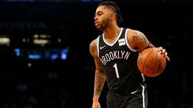 D'Angelo Russell of the Nets controls the ball