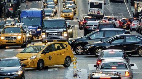 Traffic on East 42nd Street in Manhattan looking
