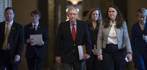 Senate Majority Leader Mitch McConnell, R-Ky., walks to