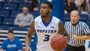 Hofstra guard Justin Wright-Foreman brings the ball upcourt