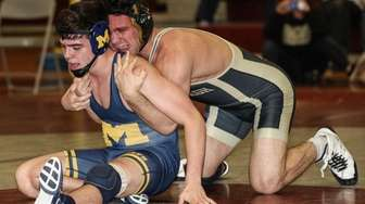 Massapequa's John Casanassina can't break the hold of