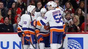 Islanders defenseman Ryan Pulock celebrates with teammates after