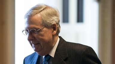 Republican Senate Majority Leader Mitch McConnell returns to