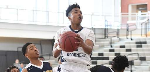Lawrence Woodmere Academy guard Tyler St. Furcy puts