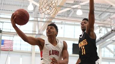 Long Island Lutheran guard Tyson Etienne puts up