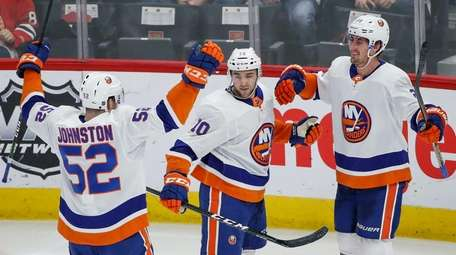 New York Islanders center Brock Nelson, right, celebrates