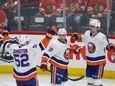 New York Islanders center Brock Nelson, right, celebrates