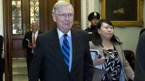 Senate Majority Leader Mitch McConnell, R-Ky., answers to