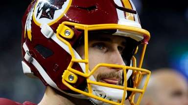 Redskins quarterback Kirk Cousins watches from the sideline