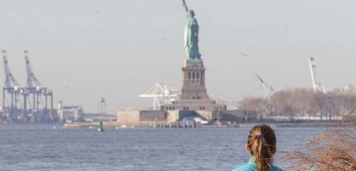 Visitors to the Statue of Liberty take in