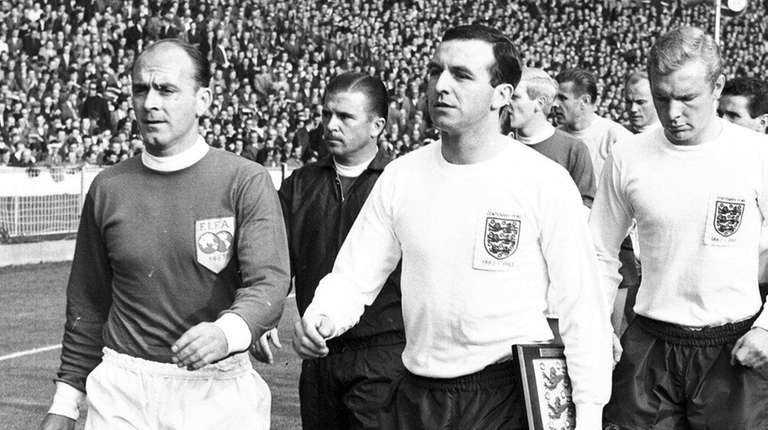 England captain Jimmy Armfield, front right, leads England