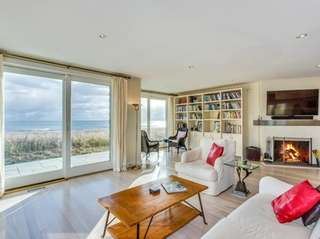 This Amagansett home features four bedrooms and includes