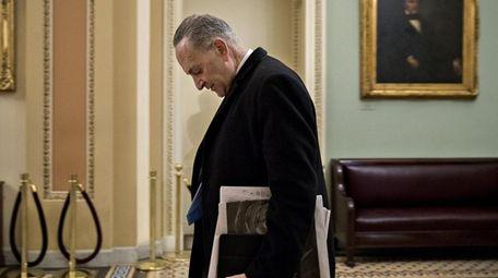 Senate Minority Leader Chuck Schumer walks to his