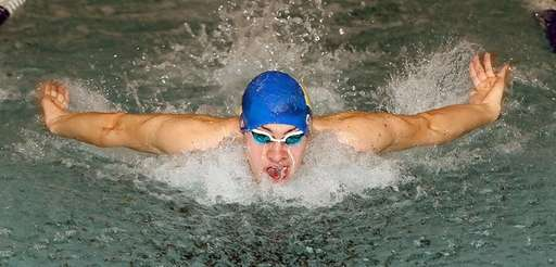 Hauppauge's Jack Casey wins the 100 yard butterfly