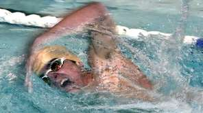 Nicholas Monaco of West Islip swims for the