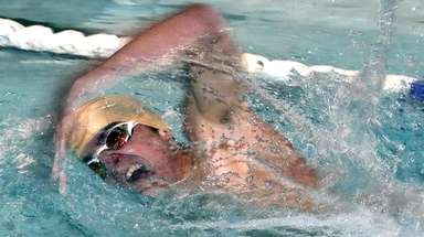 Nicholas Monaco of West Islip swims for the