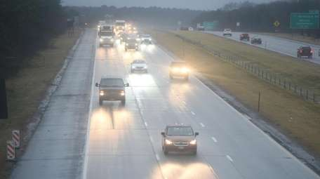 The wet eastbound Long Island Expressway in Medford