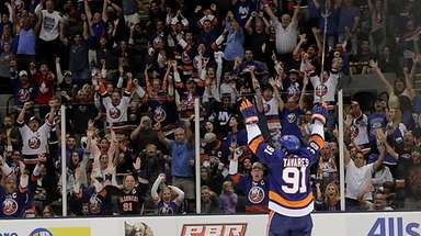 Islanders center John Tavares celebrates after scoring in