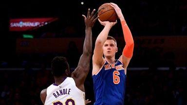 Knicks forward Kristaps Porzingis scores over Lakers forward