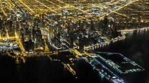Lights illuminate the downtown Chicago skyline.