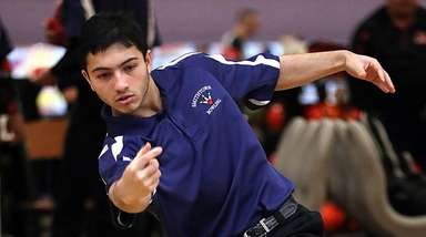 Smithtown's Eric Bholan rolls during a Suffolk bowling