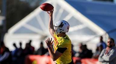 North Squad quarterback Josh Allen of Wyoming throws