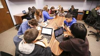 Ninth-grade students work together in a project-based learning