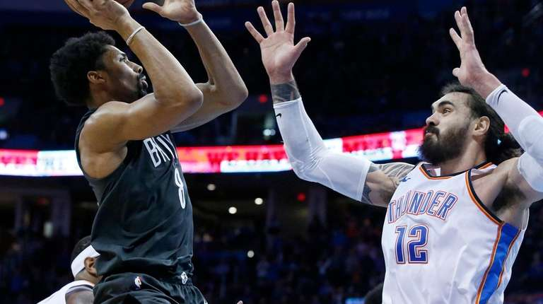 Nets guard Spencer Dinwiddie shoots over Thunder center