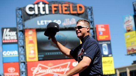 Braves third baseman Chipper Jones waves his hat