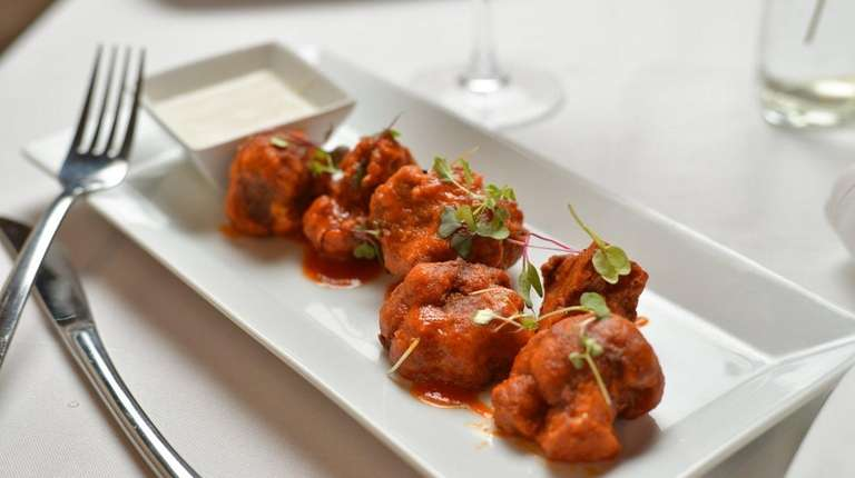 Fried Buffalo cauliflower with house-made vegan blue cheese