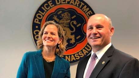 Nassau County Executive Laura Curran with acting Police