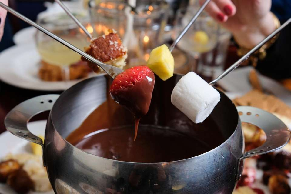 Patrons dine on chocolate fondue with marshmallow, rice