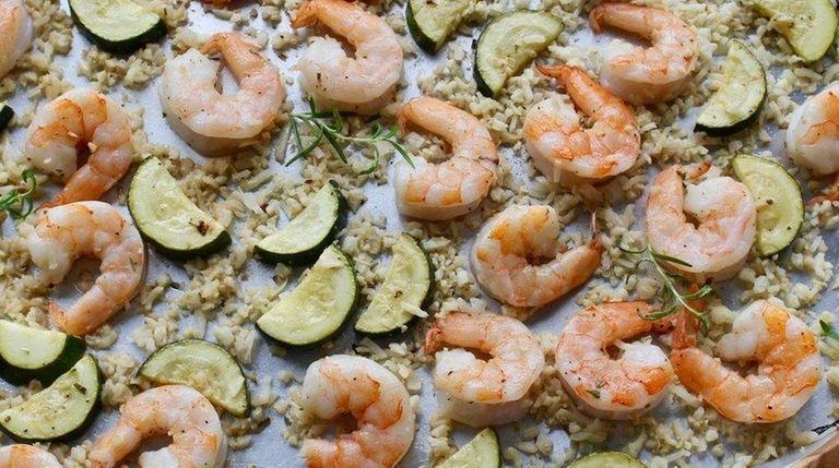 Shrimp, zucchini and cauliflower rice are roasted on