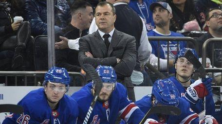 Rangers head coach Alain Vigneault watches game action
