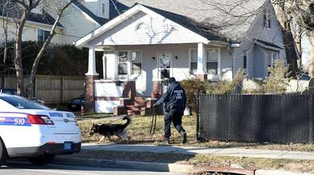 A Suffolk County police K-9 unit responds to