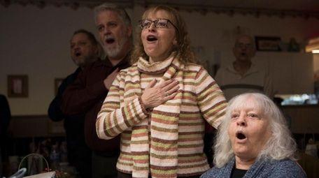 Margie Sorrentino, right, sings