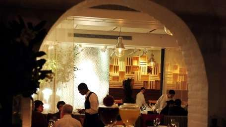 A waiter takes an order in the dining