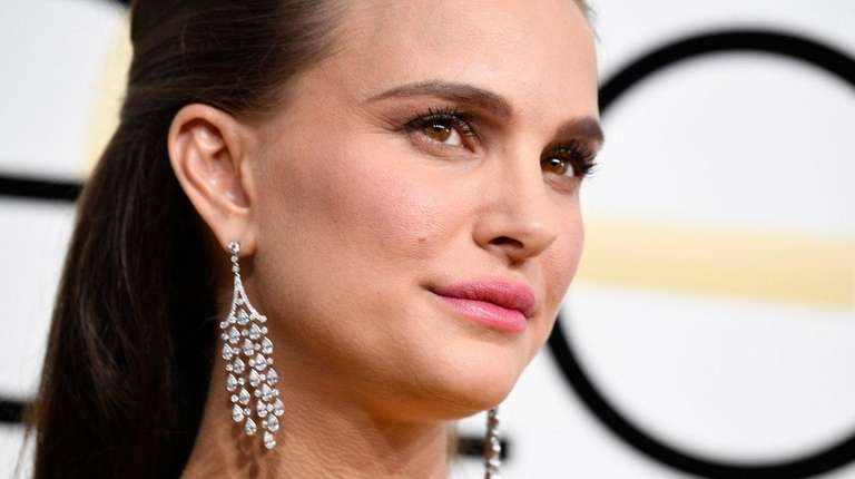 Natalie Portman attends the Golden Globe Awards in