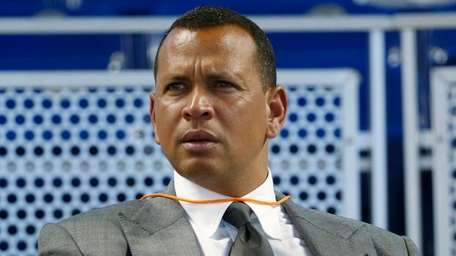 Alex Rodriguez sits in the stands before the