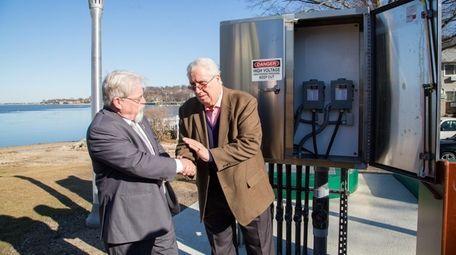 Northport Village Trustee Damon McMullen, left, shakes hands